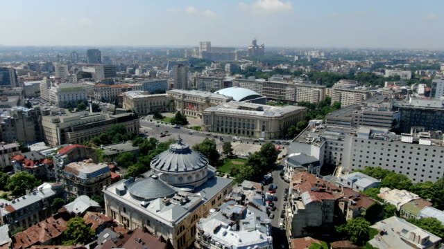 revolution square in the centre of bucharest with romanian athenaeum, national museum of art of romania/ aerial drone view - vlad the impaler stock videos & royalty-free footage
