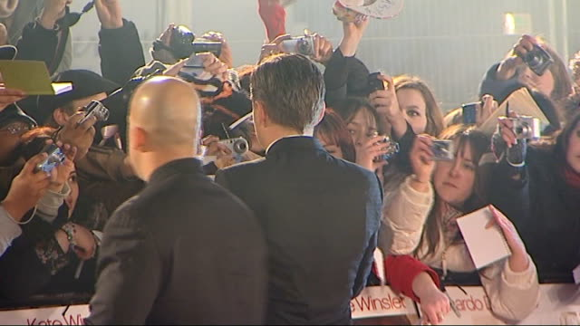 'Revolutionary Road' Leicester Square premiere red carpet arrivals Leonardo Di Caprio signing autographs for fans/ Kate Winslett talking to press and...