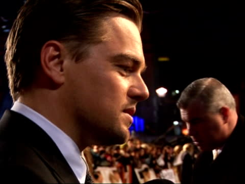 'revolutionary road' premieres in london's leicester square; leonardo dicaprio interview sot - on being happy to work with kate winslet on... - kate winslet stock videos & royalty-free footage