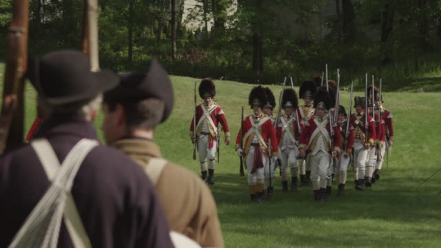 revolutionary soldiers marching in line toward each other - war reenactment stock videos & royalty-free footage