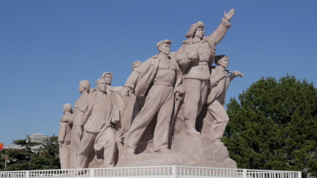 revolutionary statues at tiananmen square, beijing, china - tiananmen square stock videos and b-roll footage