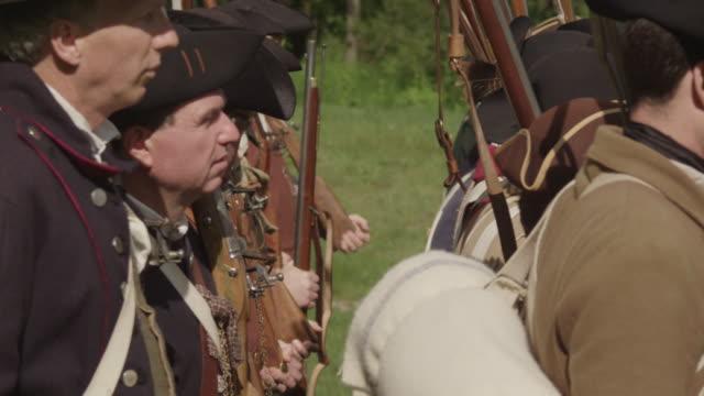revolutionary war reenactors lining up on battlefield - revolution stock videos & royalty-free footage