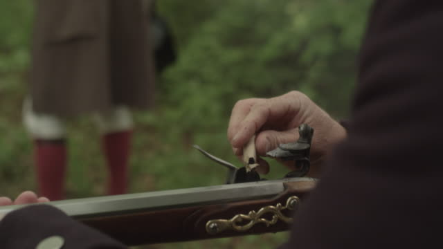 revolutionary war soldier wearing bedroll fires musket - rifle stock videos & royalty-free footage