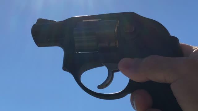 revolver and sunlight - handgun stock videos and b-roll footage