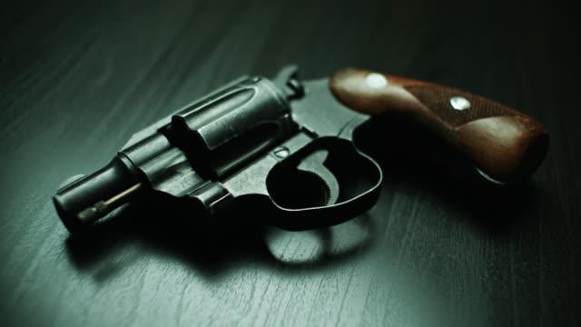 revolver on dark background - handgun stock videos & royalty-free footage
