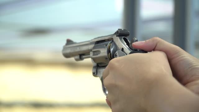 revolver shooting and smoking, slow motion - gun barrel stock videos & royalty-free footage