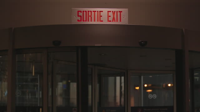 revolving door at montreal airport - exit sign stock videos & royalty-free footage