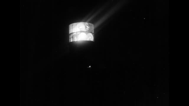 revolving lighthouse light surrounded by darkness / man's silhouette against light he descends unseen stairs out of sight / light man's silhouette... - lighthouse stock videos & royalty-free footage