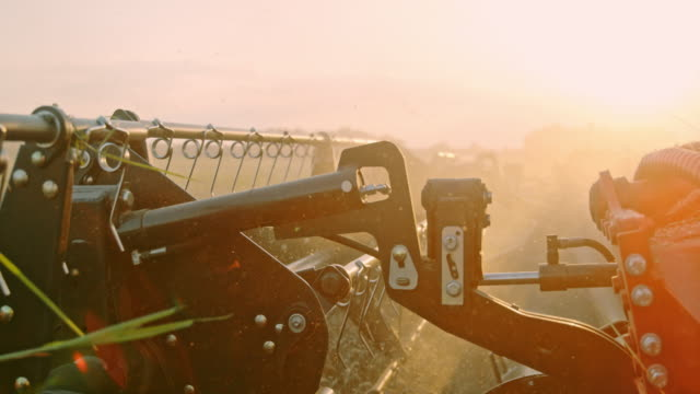 slo mo revolving reel of a combine harvester - harvesting stock videos & royalty-free footage
