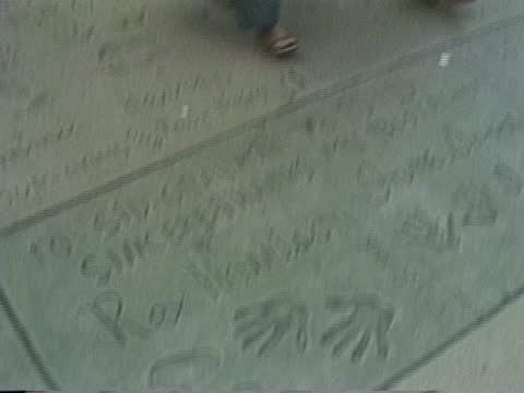 rex harrison handprints and footprints at graumann's chinese theater - 1980s - tcl chinese theatre stock videos & royalty-free footage