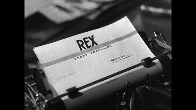 rex newspaper office, belgian men typing. rex' letterhead in typewriter. rex telephone operator entering room. operator at switchboard controls. man... - belgium stock videos & royalty-free footage