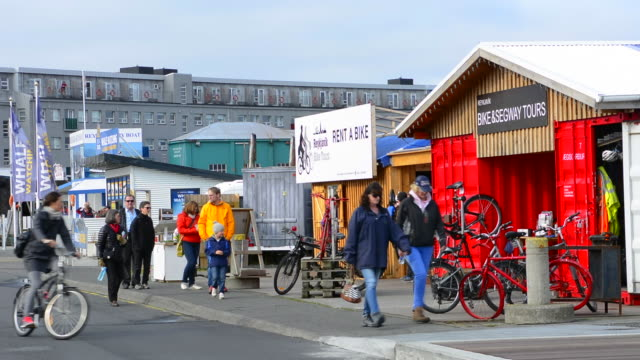 reykjavik iceland arctic downtown harbor marina colorful businesses with bicycles and tourists on pier - reykjavik stock videos and b-roll footage