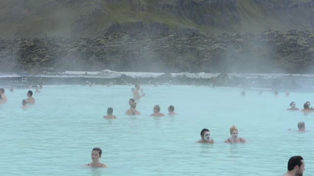 Reykjavik Iceland world famous Blue Lagoon of hot Geothermal mineral thermal springs with tourists relaxing in the warm water in Grindavik