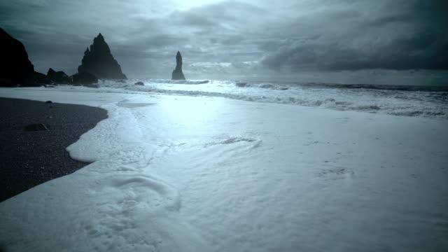 reynisfjara black sand beach in southern iceland - basalt stock videos & royalty-free footage