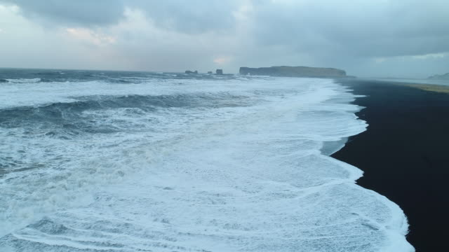 reynisfjara black sand beach, vik - black sand stock videos & royalty-free footage
