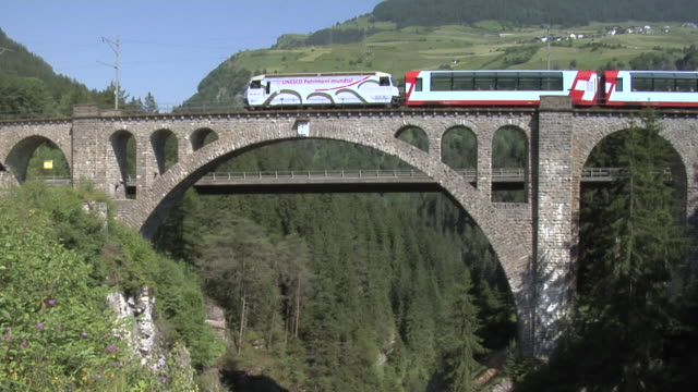 RhB Glacier Express runs over Solis viaduct