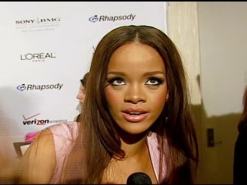 Rhianna on Clive Davis on the event at the Clive Davis' PreGrammy Awards Party at the Beverly Hilton in Beverly Hills California on February 10 2007
