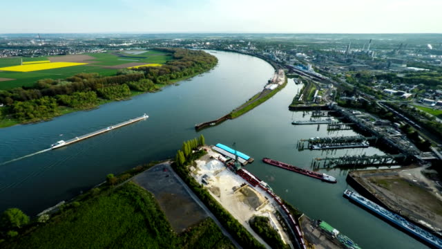 aerial: rhine river and industrial port - river rhine stock videos & royalty-free footage