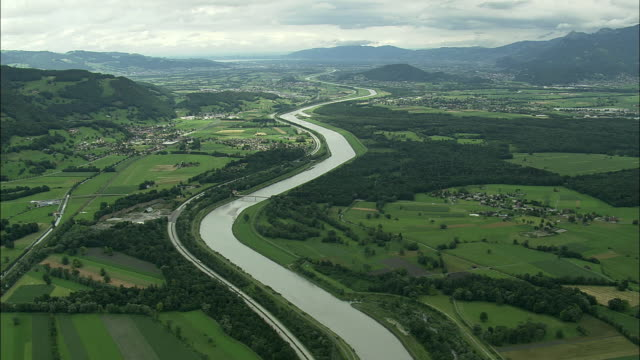 aerial rhine river crossing appenzell mountains valley, switzerland - rhein stock-videos und b-roll-filmmaterial