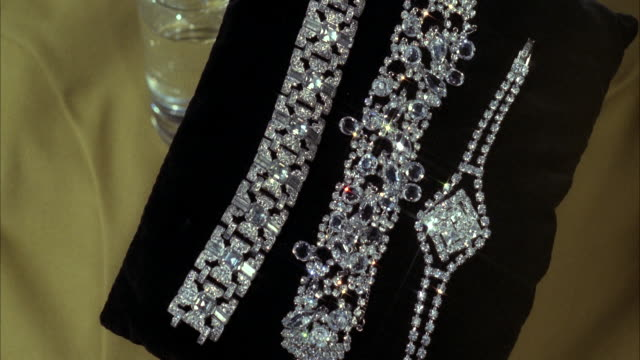 cu rhinestone or diamond bracelets on black velvet - bracelet stock videos and b-roll footage