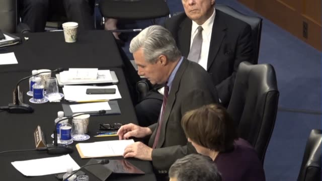 Rhode Island Senator Sheldon Whitehouse reads from a prepared statement at a meeting of the Senate Judiciary Committee prior to a vote on sending the...