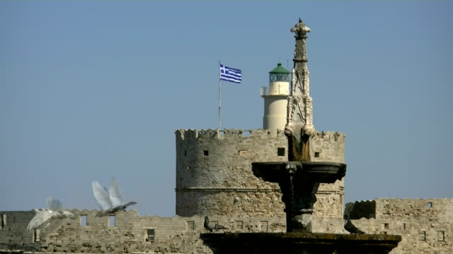 rhodes greece lighthouse and foundain with doves - rhodes dodecanese islands stock videos & royalty-free footage