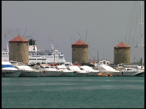 stockvideo's en b-roll-footage met rhodes, greece: windmills at port with cruise ship and marina - rodos dodecanese eilanden