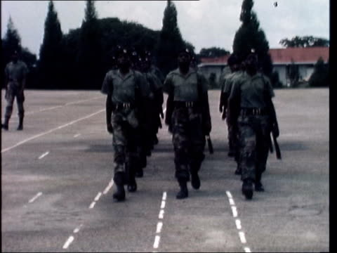 Rhodesian army *ALSO AVAILABLE AS FS180277008* MS Group of Troops run towards and LR with rifles MS Troops march towards on parade ground CS Pull Out...