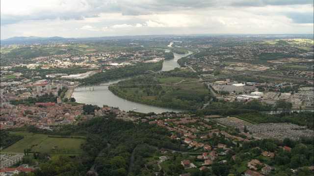 aerial ws rhone river at givors looking north toward lyon / givors, rhone, france - rhone river stock videos & royalty-free footage