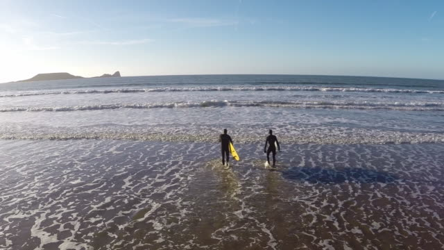 rhossili bay wales surfers - wales stock videos & royalty-free footage