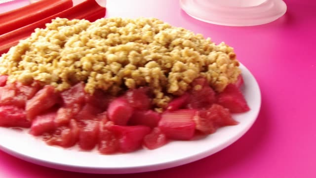 rhubarb crumble - crumble dessert stock videos and b-roll footage