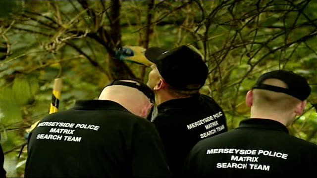 police begin search of woodland area; england: liverpool: croxteth: ext senior police officers searching in woodland area for evidence relating to... - merseyside stock videos & royalty-free footage