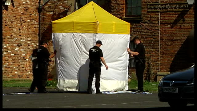 police find gun used in the shooting t23080715 croxteth ext police erecting forensic tent and cordon tape in car park of fir tree pub following rhys... - t in the park stock-videos und b-roll-filmmaterial