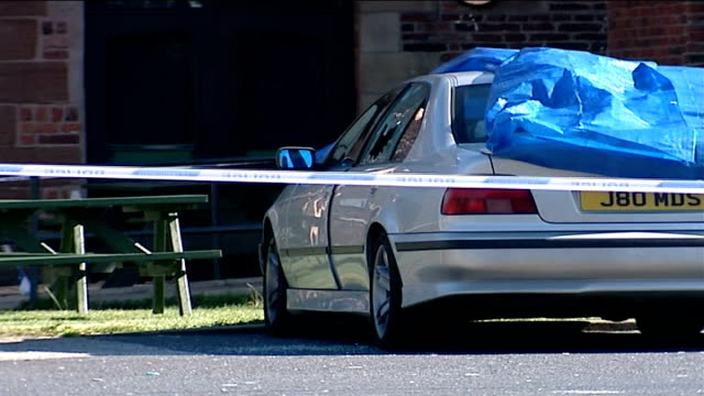 tributes and police investigation ext car with shatterd window in car park of fir tree pub police forensic tent in pub car park police officer at car... - fir tree stock videos and b-roll footage
