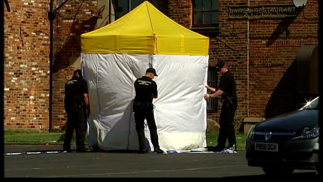 tributes and police investigation; police erecting forensic tent and cordon tape in car park of fir tree pub - pinaceae stock videos & royalty-free footage