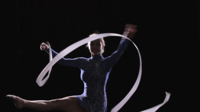 SLO MO Rhythmic gymnast performing with a rope / Auckland, New Zealand