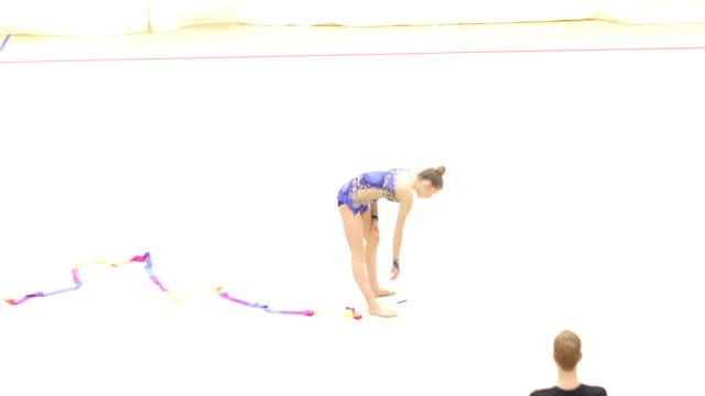 rhythmic gymnastics coach guiding young athlete practicing - rhythmic gymnastics stock videos & royalty-free footage