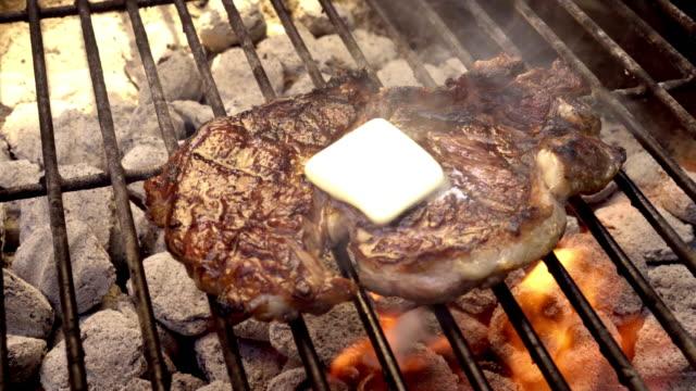 Rib Eye Beef Steak on a Sizzling Grill