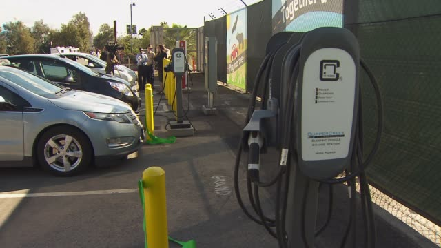 ktla ribbon cutting ceremony for la zoo's new electric charging stations on november 4 2015 - charging sports stock videos & royalty-free footage