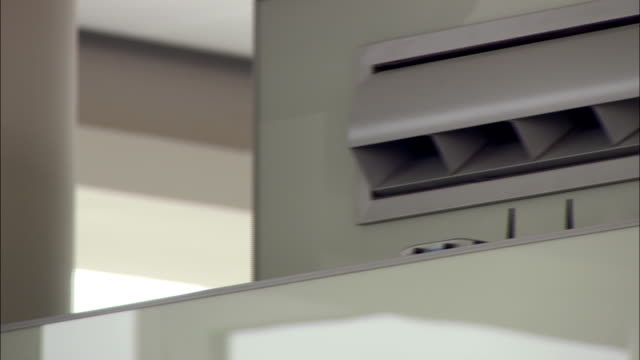 a ribbon flutters as it hangs in an air conditioner vent at the hongqiao hub. - air duct stock videos & royalty-free footage