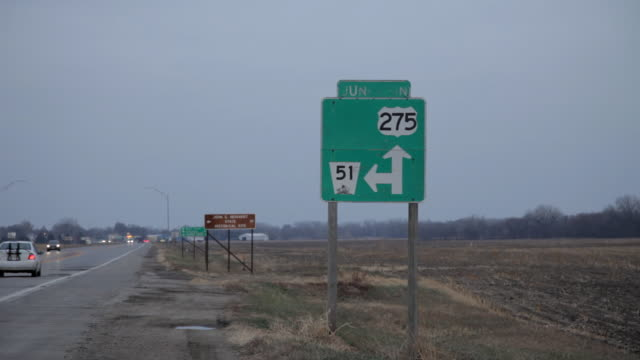 Ribbon of rural highway with cars driving to the horizon, 'Junction of highway 275 and 51.'