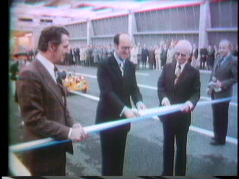 vídeos de stock, filmes e b-roll de ribbon-cutting ceremony dedicates the opening of a giant air raid center in lucerne, switzerland. - air raid