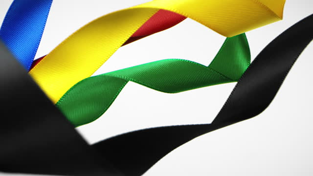 ribbons in olympic colors on white background, for celebration events and party for new year, birthday party, christmas or any holidays, waiving and curling in super slow motion and close up - satin stock videos & royalty-free footage