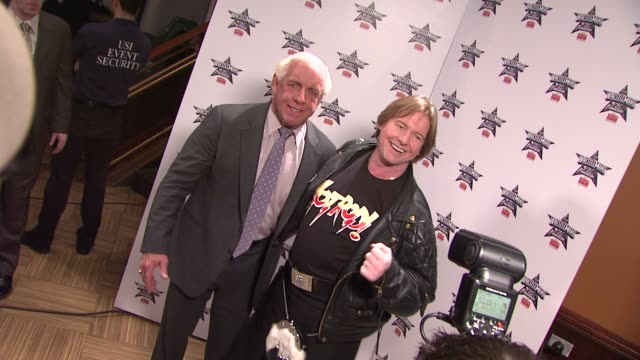 ric 'nature boy' flair and 'rowdy' roddy piper at the wrestlemania 25th anniversary press conference at new york ny - play fight stock videos and b-roll footage