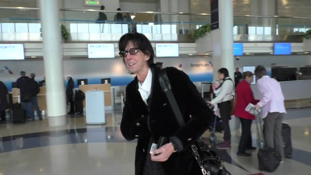 ric ocasek from the cars talks about wearing felt as he departs at lax airport in los angeles in celebrity sightings in los angeles, - the cars stock videos & royalty-free footage