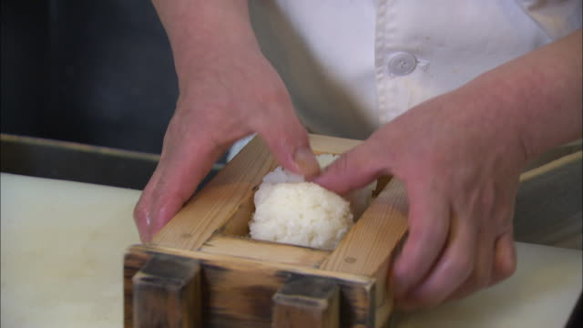 rice being put in a wooden sushi frame in osaka, japan - rectangle stock videos & royalty-free footage