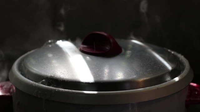 rice cooker lid boiling water. - boiling water stock videos and b-roll footage