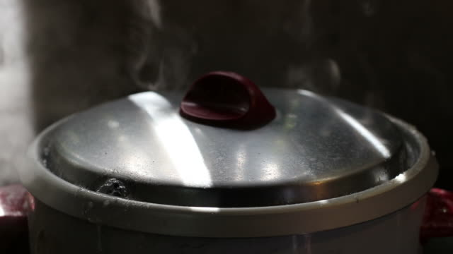 rice cooker lid boiling water. - lid stock videos and b-roll footage