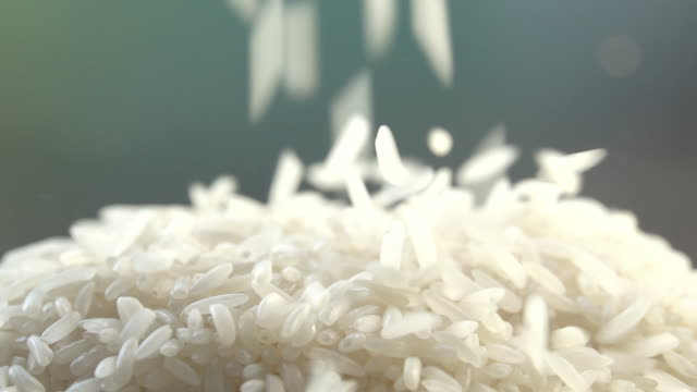 rice falling to heap slow motion - rice stock videos & royalty-free footage