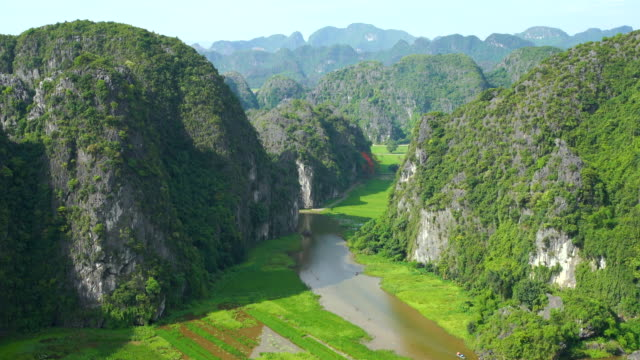 WS ZO Rice field and river 'Ngo Dong' in valley at TamCoc famous for tourist, Ninhbinh, Vietnam;